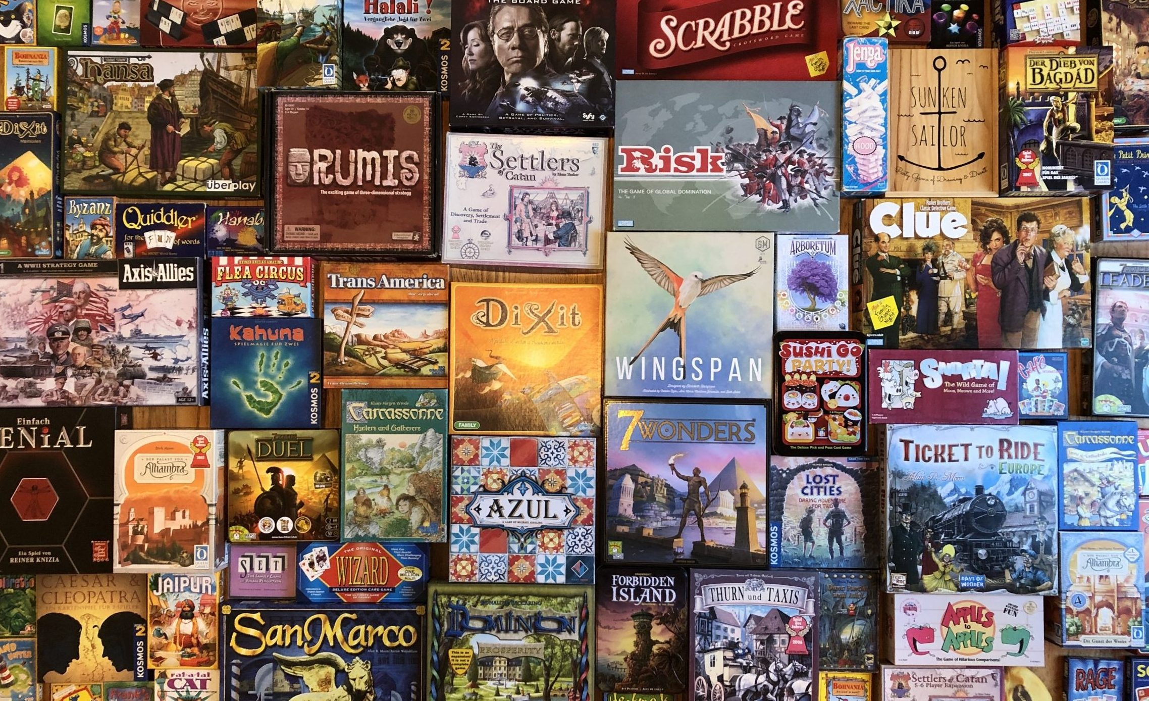 Mosaic of board games, including Azul, Wingspan, Jaipur, Ticket to Ride, 7 Wonders, Alhambra, Dixit, Carcassone, Lost Cities and Bohnanza